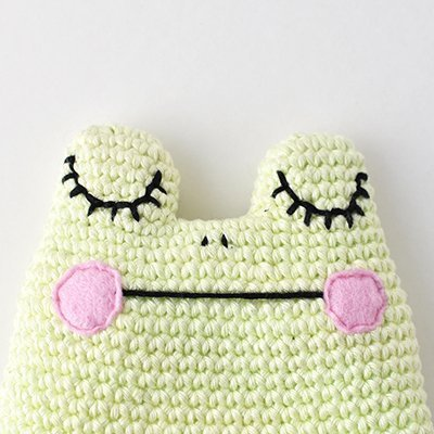 Face embroidery complete for the this Amigurumi Frog free crochet pattern.