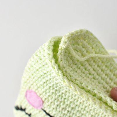 Unstuffed flat Amigurumi Frog depicting how to crochet the bottom panel on.