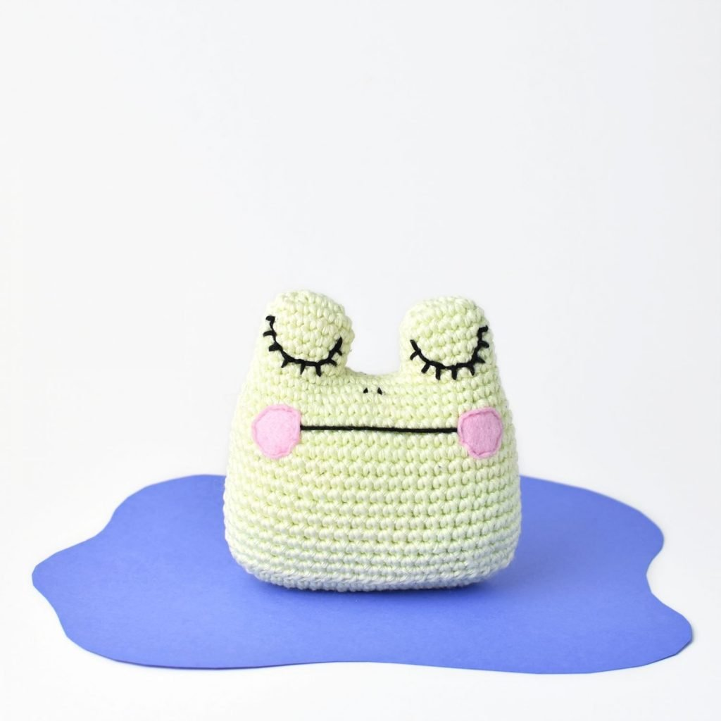 Amigurumi Frog sitting in a pond for the free crochet pattern by Tiny Curl.
